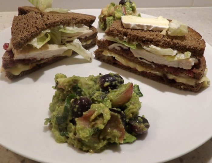 turkey,bacon,brie,club,sandwich,with,guacamole,peaches,and,grapes