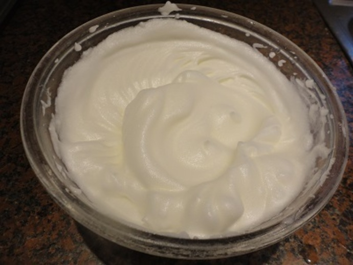Whisk the egg whites and lemon juice until they form soft peaks